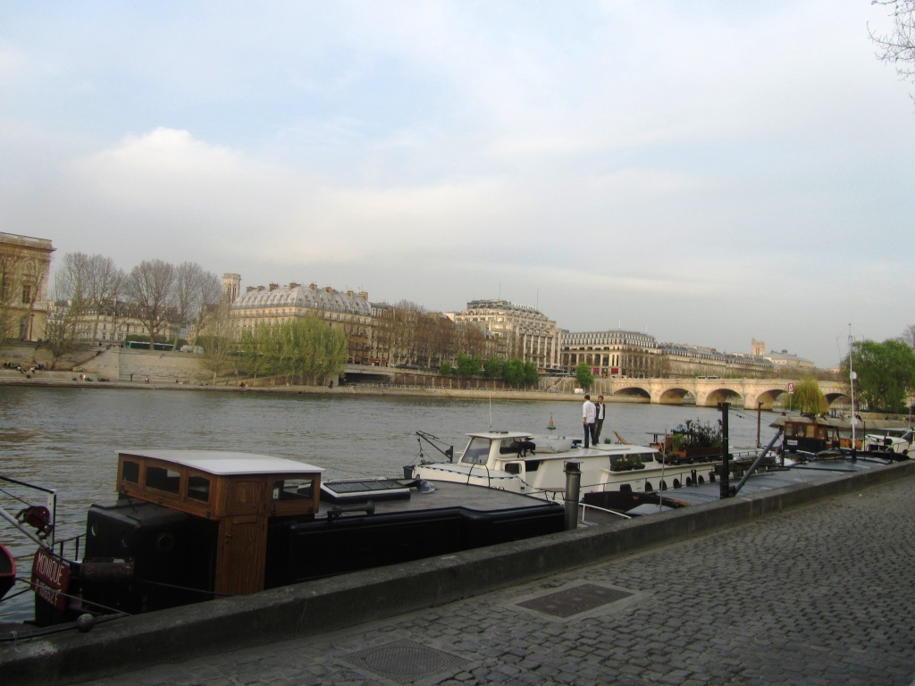 """Barges parked along the Seine in Paris"""