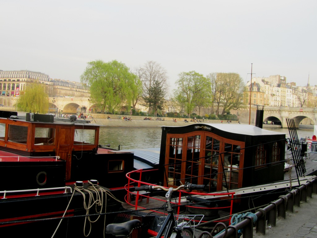"""house boats by the Seine in Paris"""