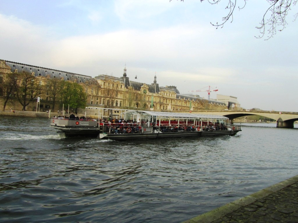 """Tourist river boat on the Seine in Paris"""
