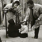 """Sydney Poitier and Diahann Caroll on the steps of rue Chappe in the movie Paris Blues"""