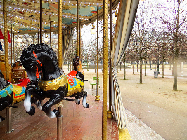 """A cold drizzly romantic Paris view of the Carousel in the Jardin des Tuileries"""